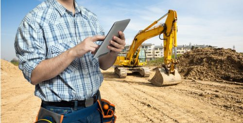Worker using a tablet in a constuction site