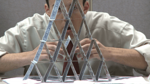 man-building-house-of-cards_