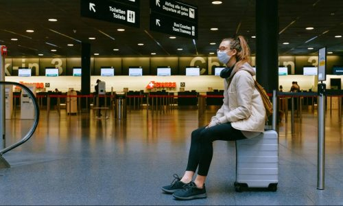 woman-sitting-on-luggage